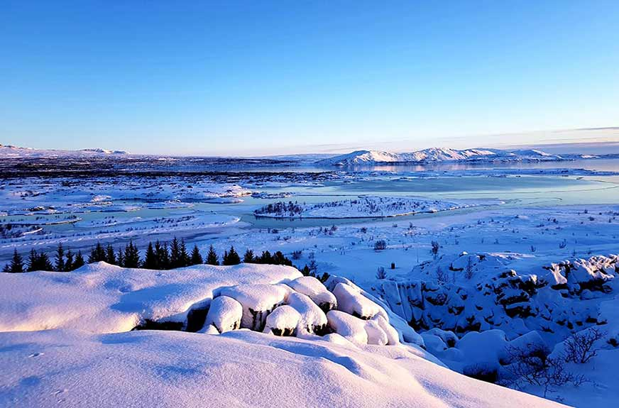 Snow over Thingvellir National Park at dusk