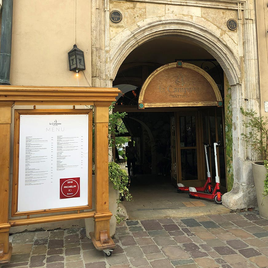 Entrance of the Campana Trattoria restaurant in Krakow