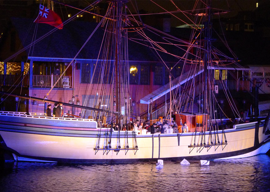 Replica of one of the Boston Tea Party ships at night
