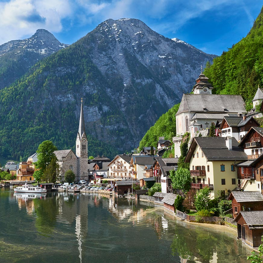 Hallstatt Lake with traditional alpine houses on the shore and the mountain in the background